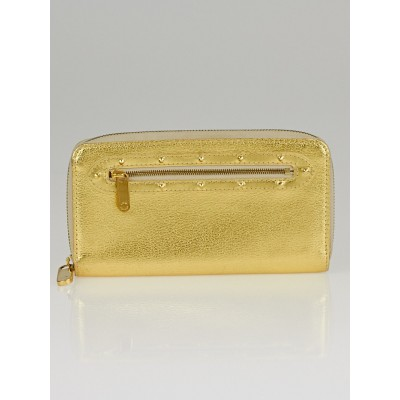 Louis Vuitton Gold Suhali Leather Zippy Wallet