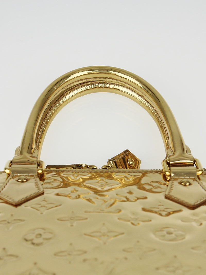 Louis vuitton limited edition gold monogram miroir alma mm for Monogram miroir