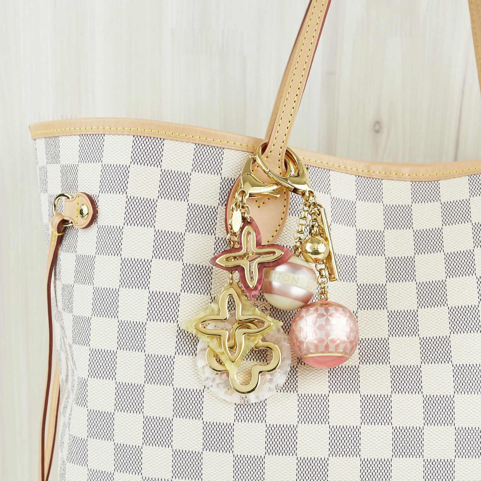 Louis Vuitton Damier Azur Neverfull Tote with Bag Charms | Yoogi's Closet Authenticated Pre-Owned Luxury yoogiscloset.com