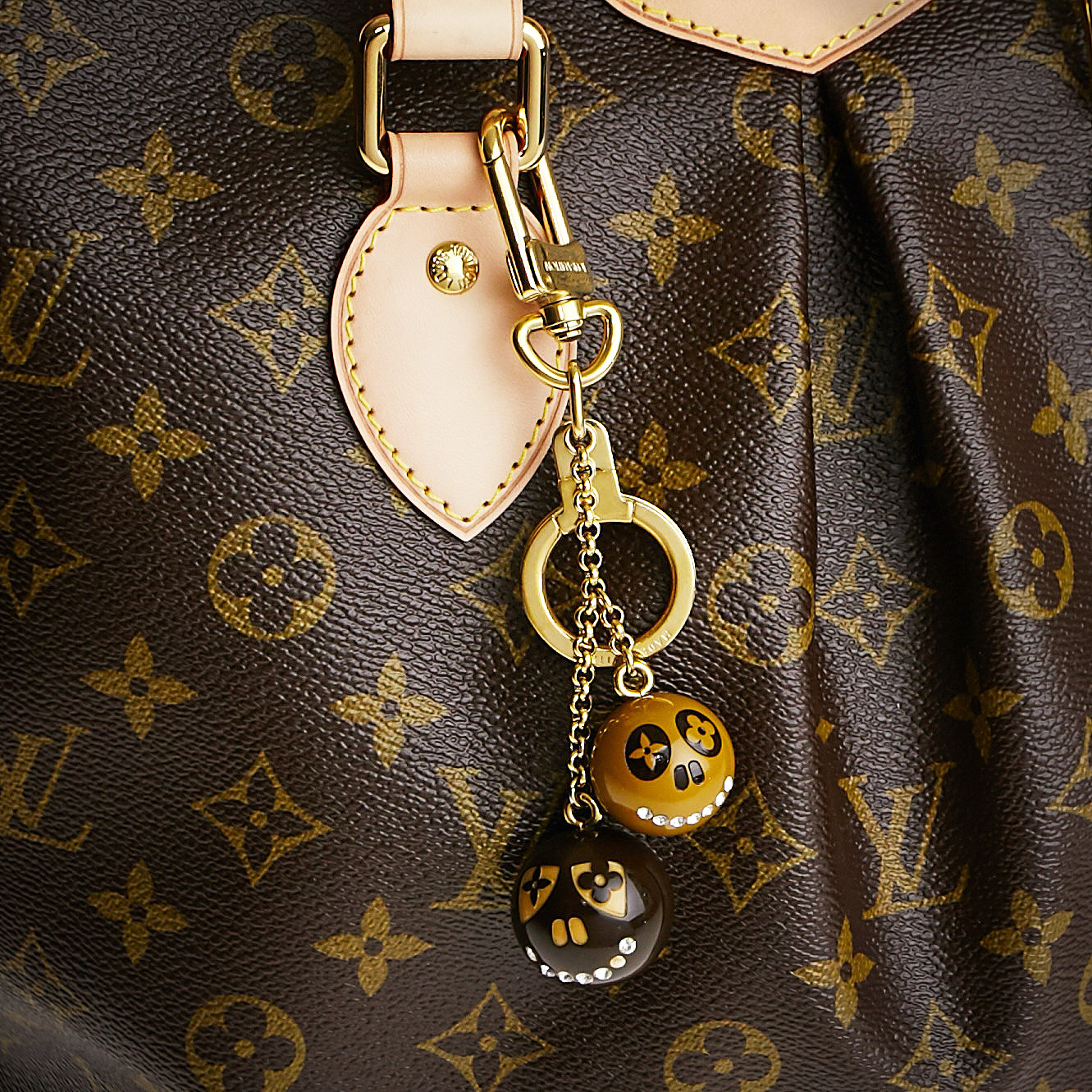 Louis Vuitton Jack and Lucie Skull Bag Charm | Yoogi's Closet Authenticated Pre-Owned Luxury yoogiscloset.com